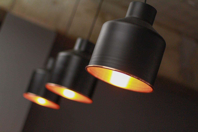 Dashing dark pendant lights in black for the modern Scandinavian style office