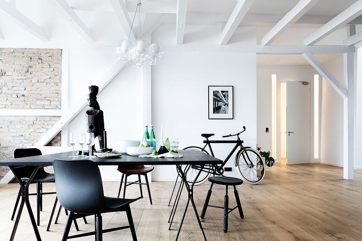 Dining area of the Berlin loft with industrial chic style
