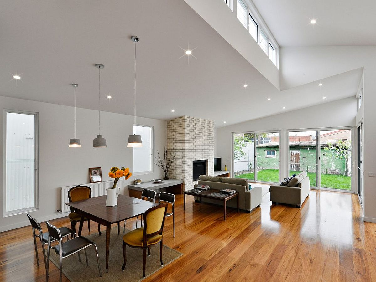 Double-height-interior-of-the-revamped-Melbourne-home-with-a-cheerful-dining-area