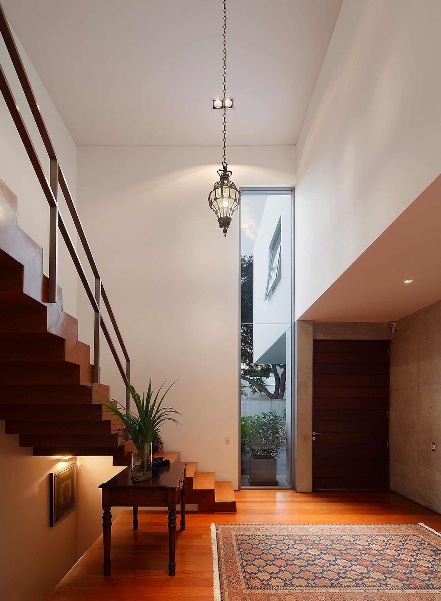 Double height lower level of the house gives the interior an airy vibe