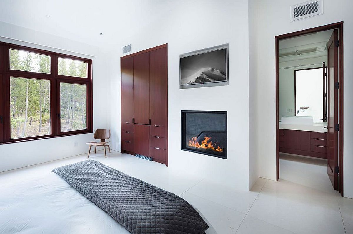 Fireplace adds warmth and elegance to the bedroom in white