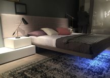 Floating-bed-with-a-large-plush-headboard-and-cool-side-tables-217x155