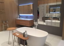 Floating-wooden-vanity-with-fabulous-lighting-and-wall-mounted-shelves-217x155