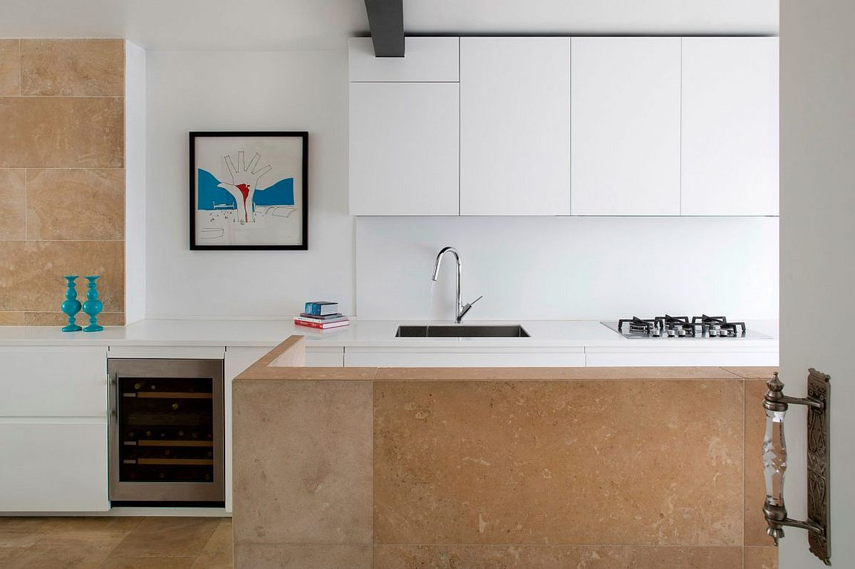 French honey-color limestone brings warmth to the neutral interior