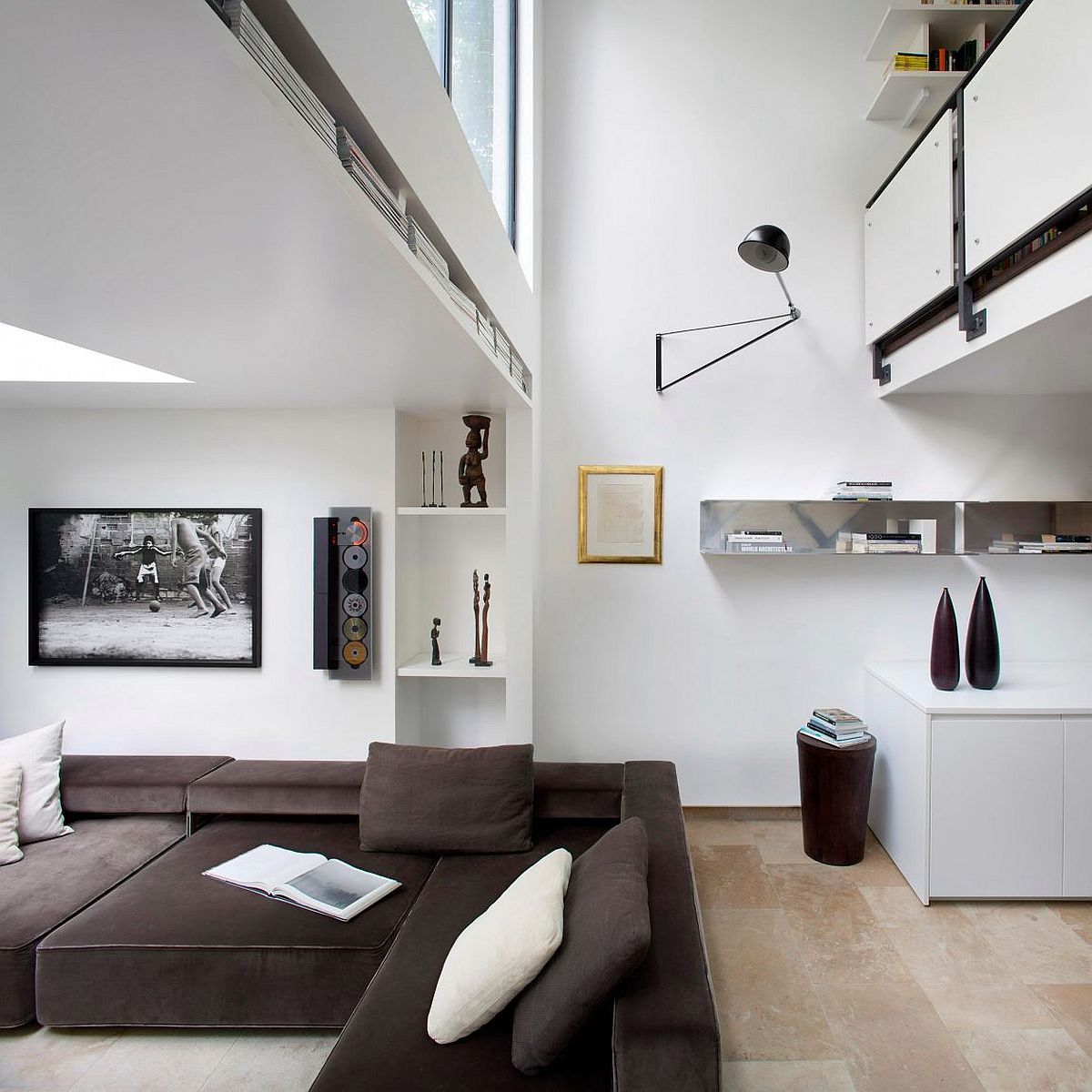 Glass windows and improvised ceiling design give the interior an airy appeal
