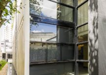 Glass-windows-bring-ample-natural-light-into-the-invetive-office-217x155