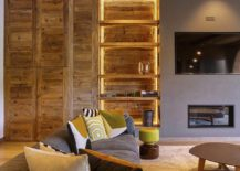 Gorgeous-lighting-adds-to-the-charm-of-the-open-wooden-shelves-and-walls-clad-in-wood-217x155