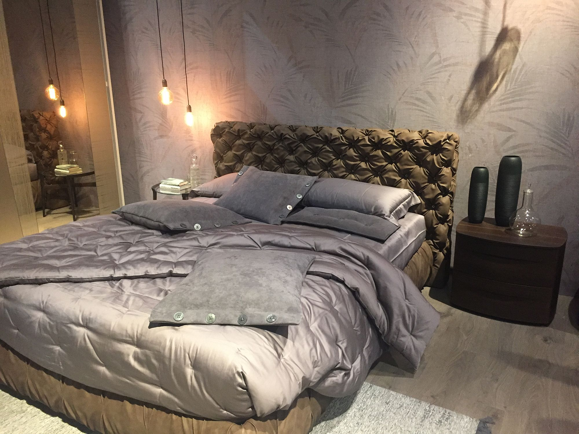 Gorgeous tufted headboard steals the show in this contemporary bedroom