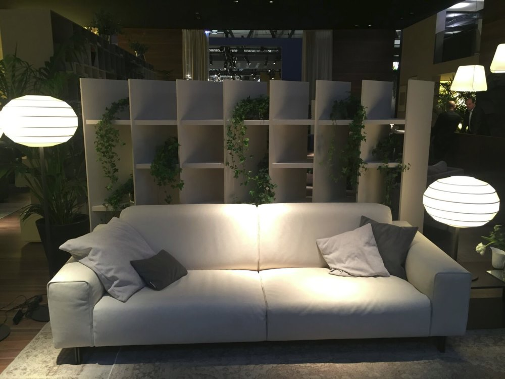 Grey throw pillows on a cream sofa