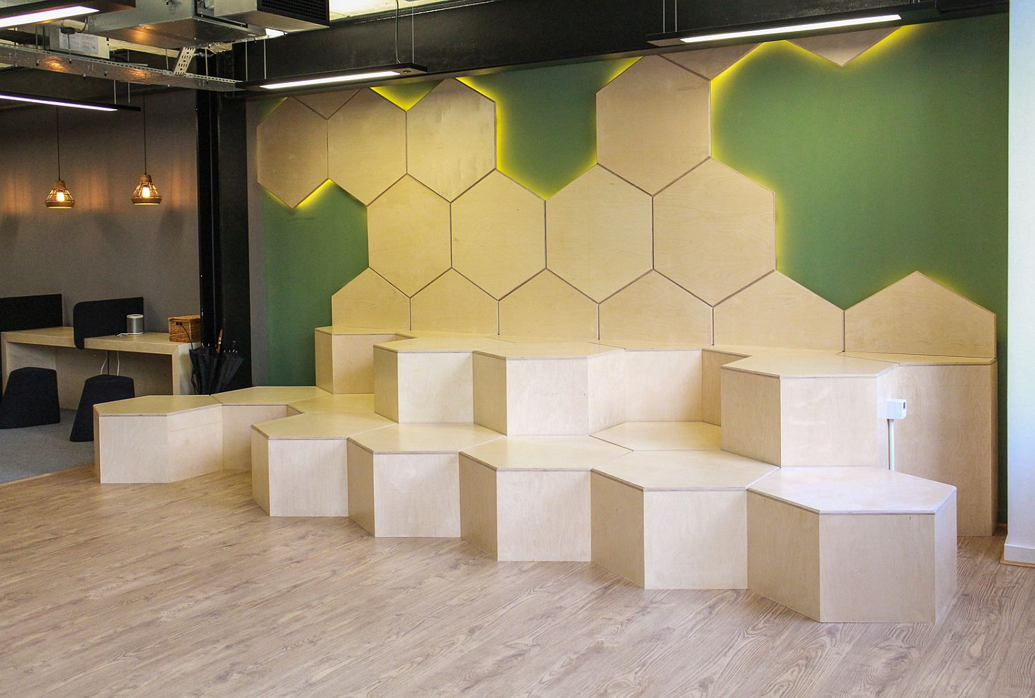 Informal hexagonal seating becomes a fun addition in the office