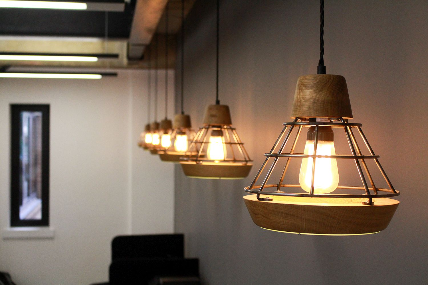 Innovative pendant lighting designed by Liqui Designs gives the office old world charm