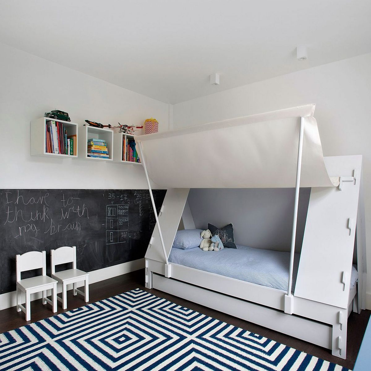 Kids' bedroom with chalkboard wall and innovative bed design