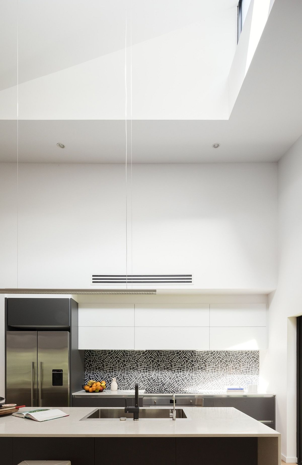 Kitchen in white with ample natural ventilation