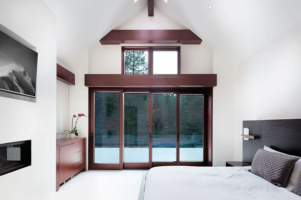 Large sliding doors connect the bedroom with the outdoors