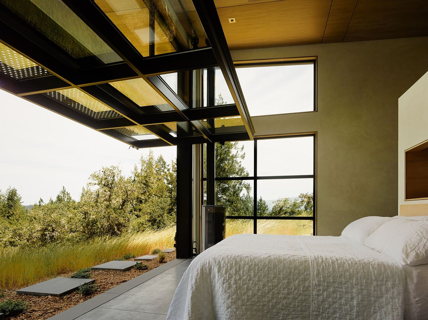 Large walls swing open to connect the bedroom with the outdoors