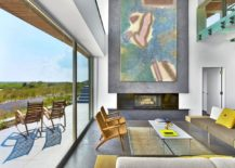 Large-work-of-art-above-the-fireplace-in-the-living-room-of-the-beach-house-217x155