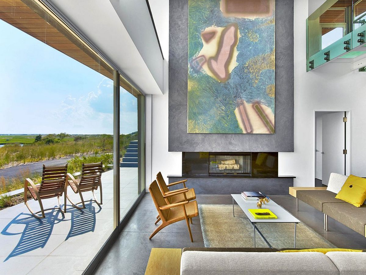 Large-work-of-art-above-the-fireplace-in-the-living-room-of-the-beach-house