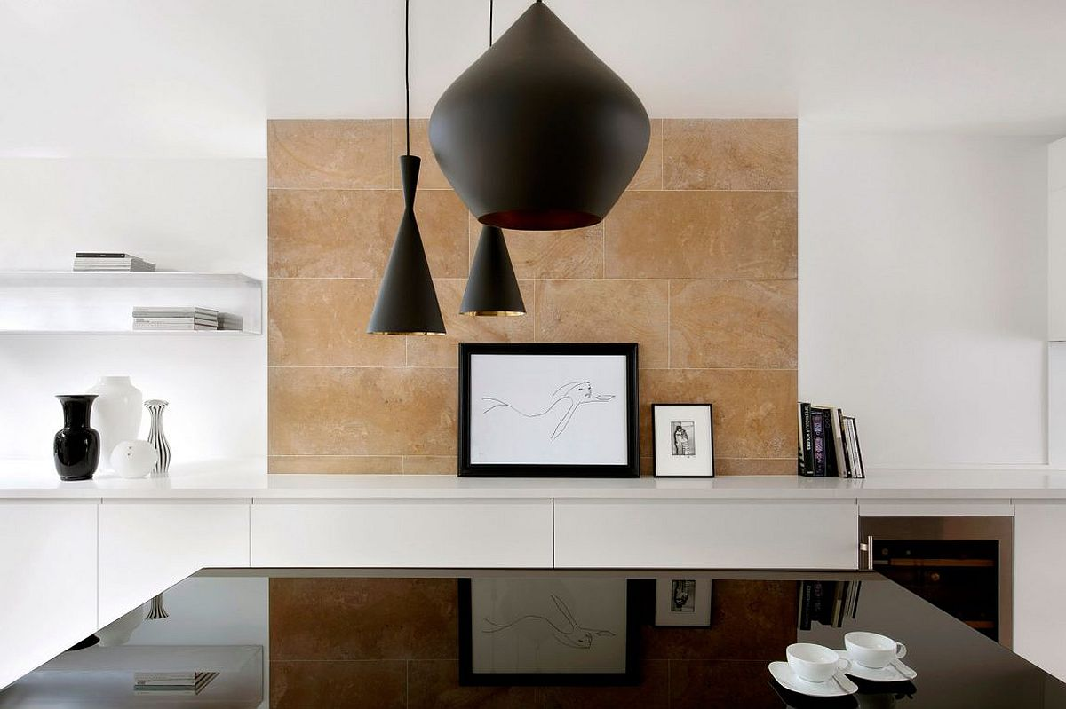 Limestone backdrop for the dining room in white with dark pendants