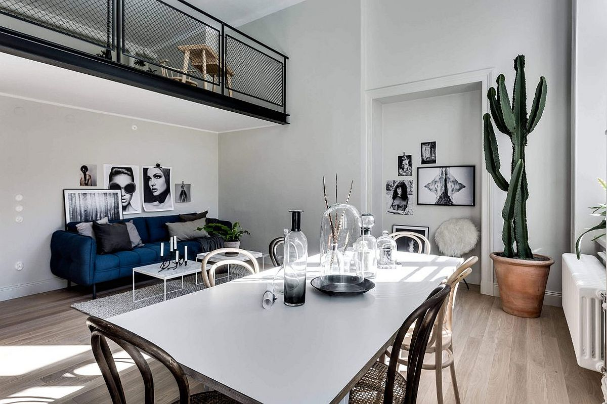 Living area and dining room of the stylish apartment in Stockholm