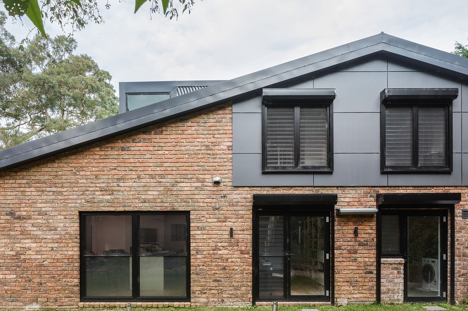 Modern addition to the 1970s brick house Down Under