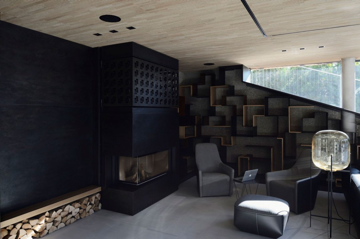 Modern fireplace and black backdrop in the living room