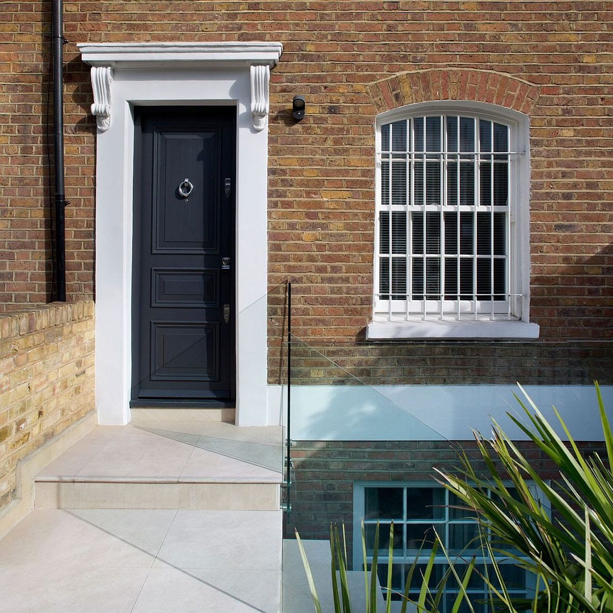 Modern makeover of classic British home on Battersea Church Road by extrArchitecture