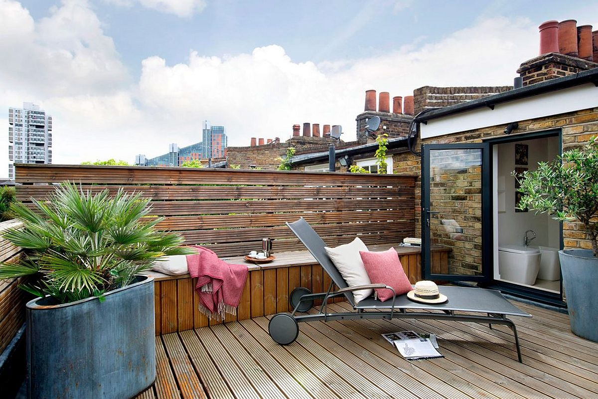 Modern wooden deck with a relaxing hangout Chic and Sensible Makeover of Lovely Brick Cottage from the 1800s in London