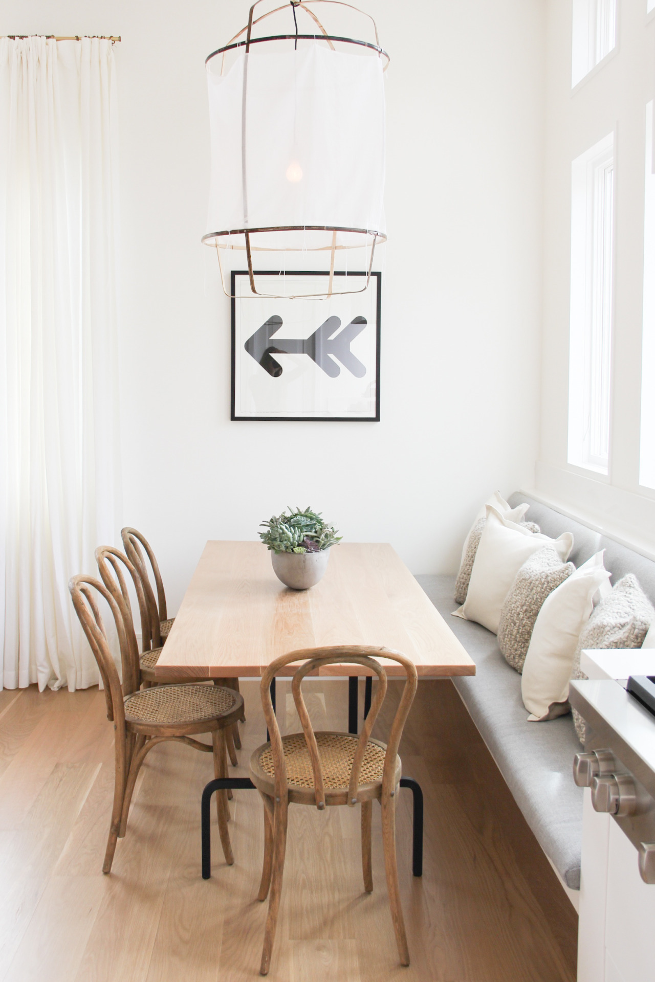 Neutral toned banquette in a minimalist setting