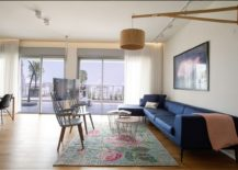 Open living space of the Israeli penthouse connected with the large balcony outside 217x155 Delineating Space Effortlessly: Urbane Penthouse Apartment in Israel