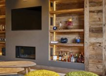 Open-wooden-shelves-next-to-the-TV-wall-in-gray-with-fireplace-below-217x155