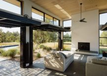 Operable doors and large glass windows connect the interior with the patio outdoor 217x155 Connecting with Nature: Open and Serene Retreat Blurs Traditional Boundaries