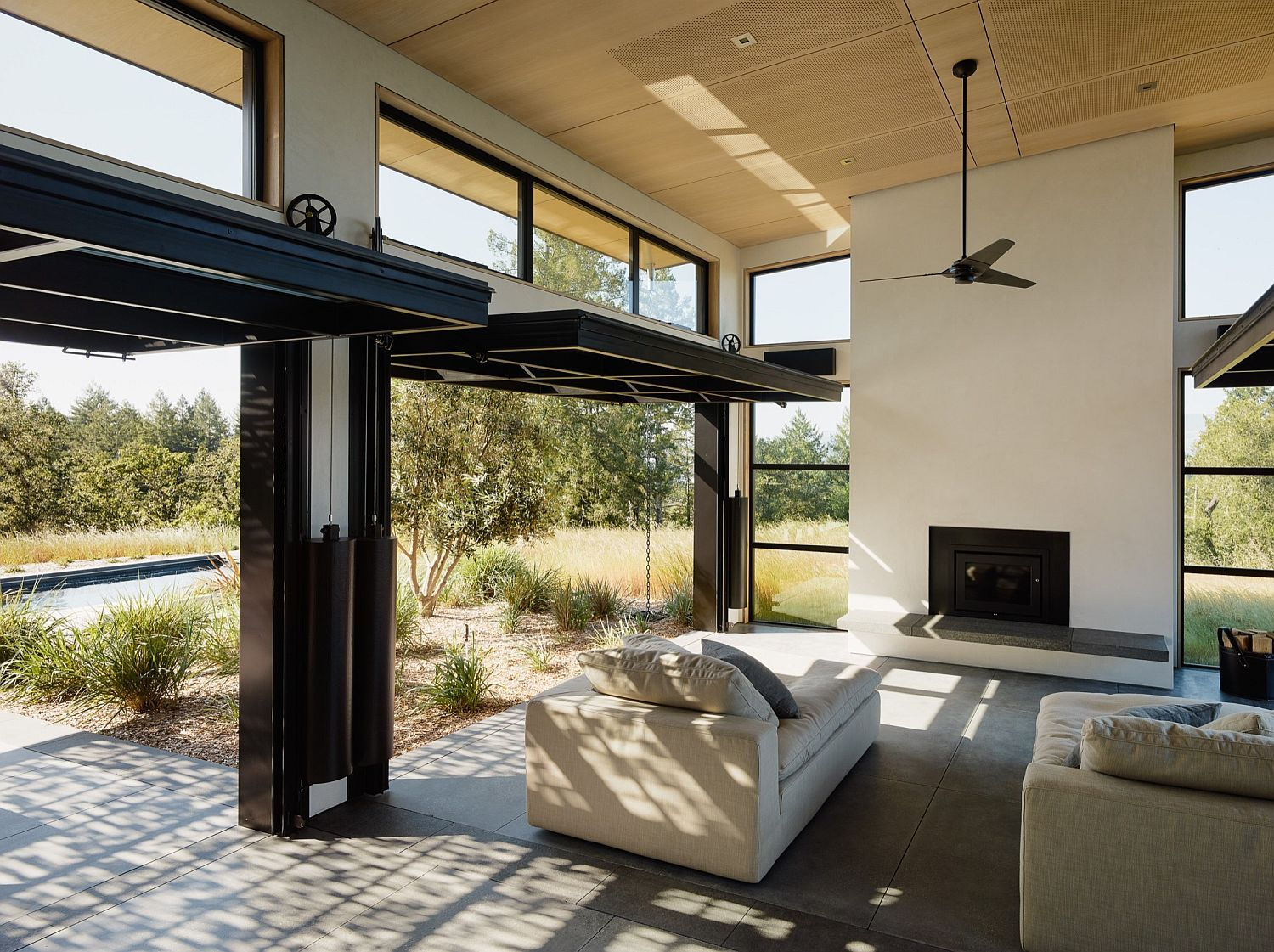 Operable doors and large glass windows connect the interior with the patio outdoor