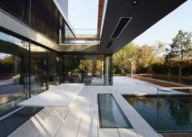 Outdoor-dining-area-and-pool-of-the-modern-house-in-Vienna-Austria-217x155