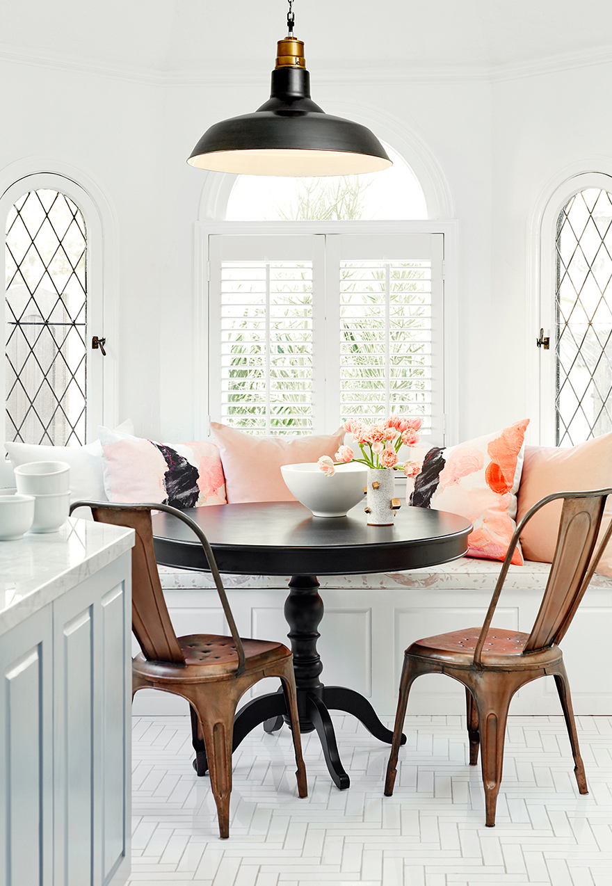 Outstanding banquette with pink pillows in a bright kitchen