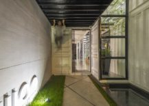 Patches-of-greenery-and-activity-zone-inside-the-sustainable-container-office-217x155