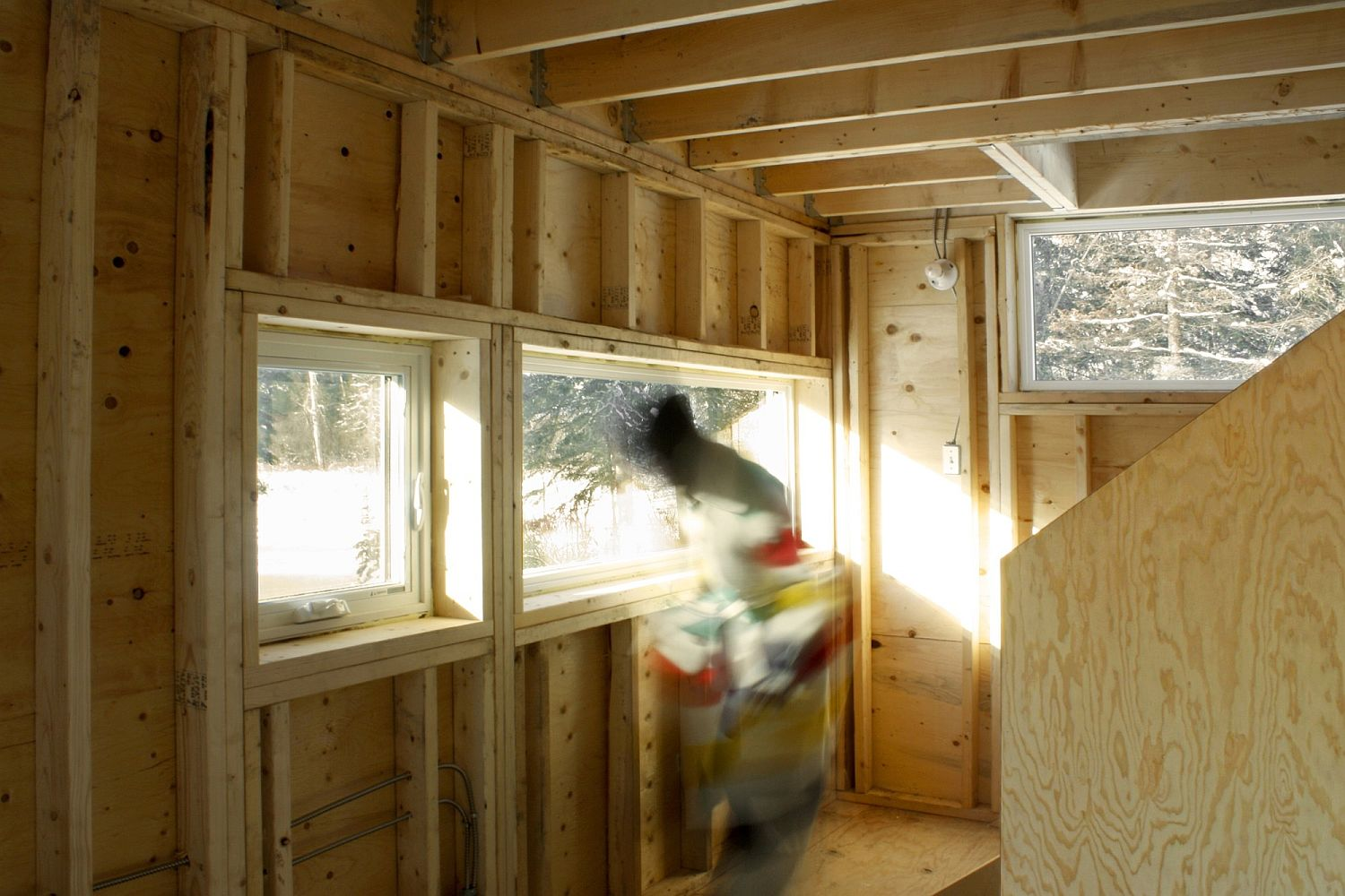 Plywood sheathing gives the interior a warm, cozy interior to the cabin