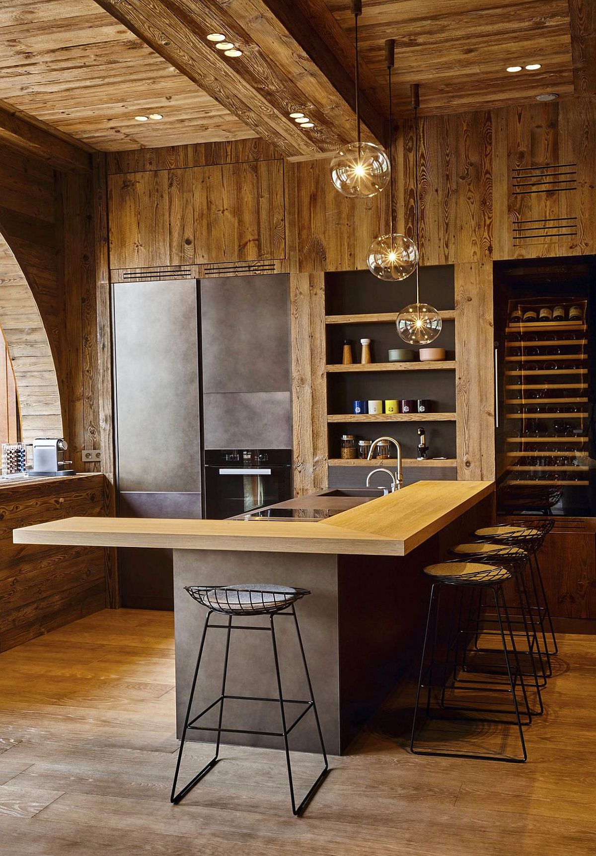 Recessed lighting coupled with sparkling pendants for the rustic modern kitchen