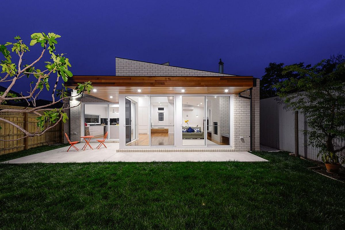 Recessed lighting illuminates the deck and the garden after sunset