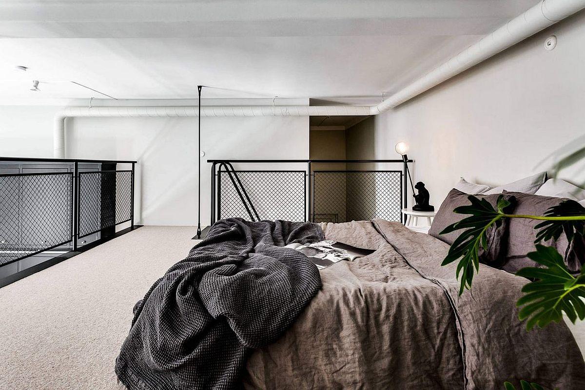 Scandinavian style mezzanine level bedroom is a space-saver