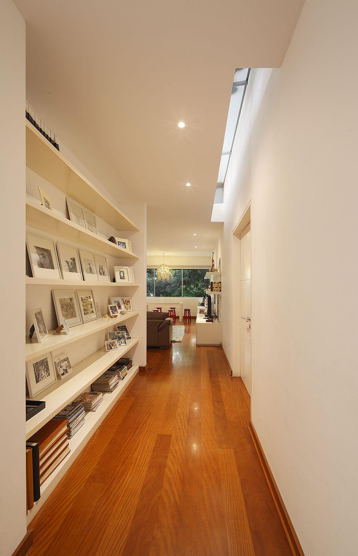 Skylight brings ventilation into the corridor with bookshelf