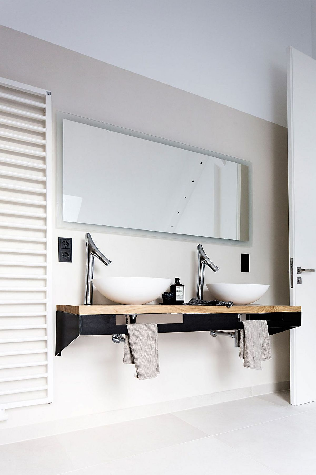 Sleek, flaoting bathroom vaity with wooden top