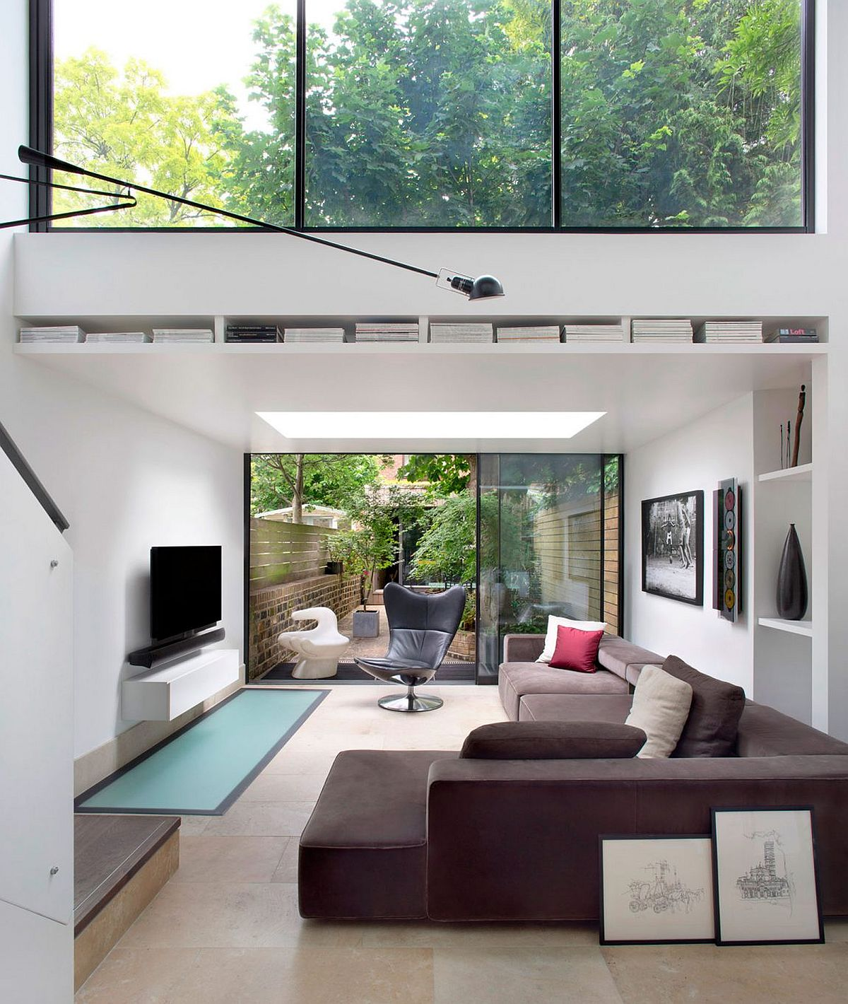 Sliding glass doors connect the living room with the rear yard