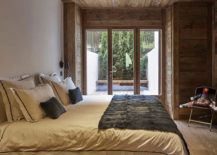 Small-bedroom-of-the-revamped-French-home-connected-with-the-balcony-outside-217x155