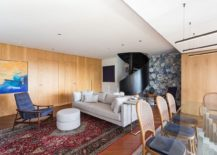 Spiral staircase and an accent wall become the focus of the gorgeous living area 217x155 Spiral Staircase and Fun Accent Wall Steal the Show at Collector's Apartment
