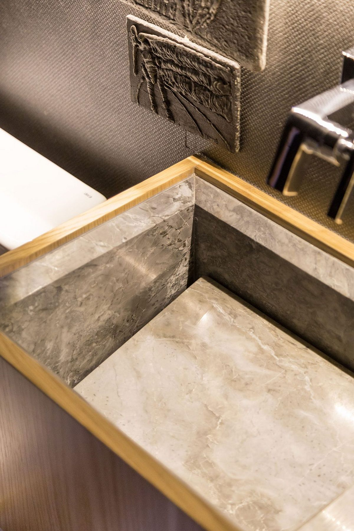 Stone sink for the bathroom with wooden vanity