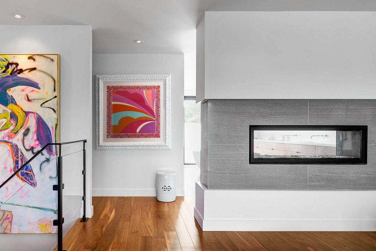 Two-sided fireplace on the upper level of the Aussie home
