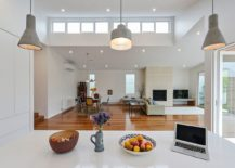 View-of-the-living-room-and-dining-space-from-the-contemporary-kitchen-in-white-217x155