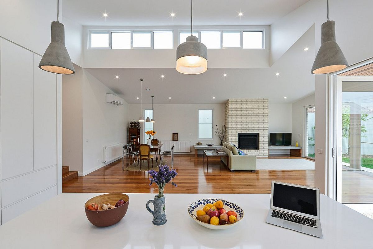 View-of-the-living-room-and-dining-space-from-the-contemporary-kitchen-in-white