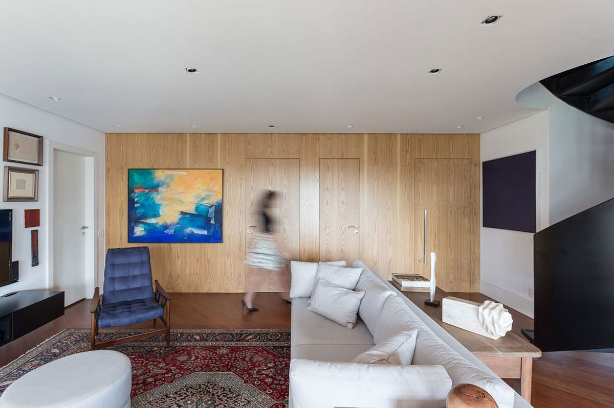Walls covered in wood add warmth to the interior