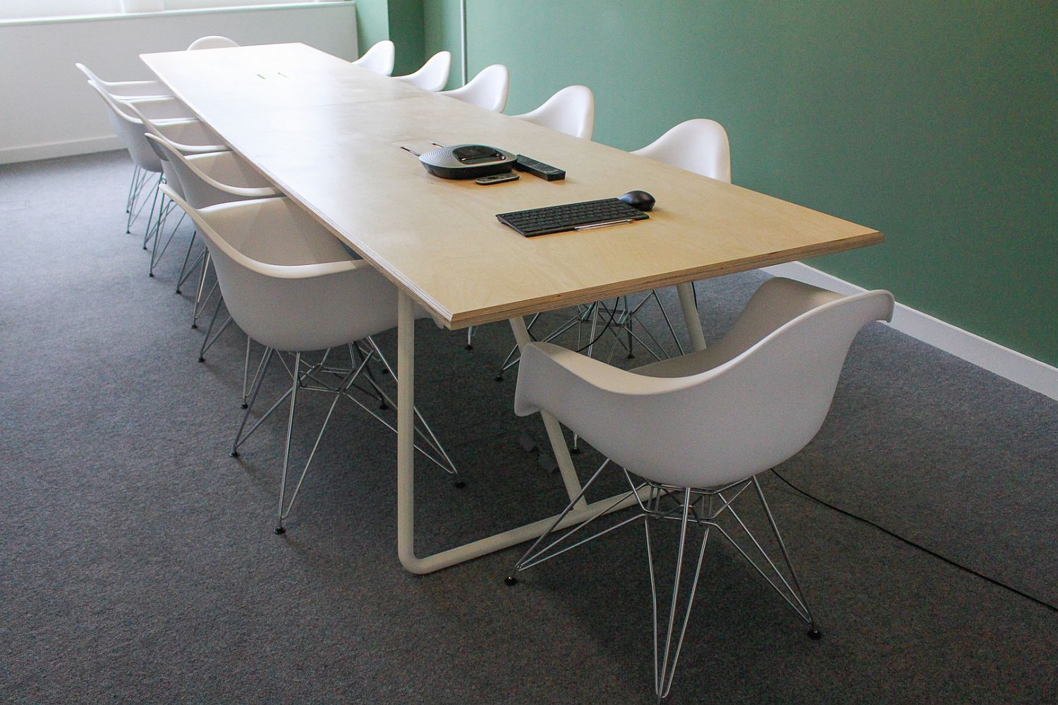 White chairs and wooden table for the office conference room
